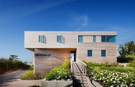 minimalist nice design of the pole barn house that has cream color