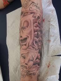 sad face sleeve tattoo