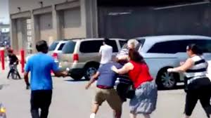 1 of the year brawl breaks out in a costco parking lot in
