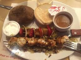 cuisine st hubert chicken brochette with baked patato picture of rotisserie st