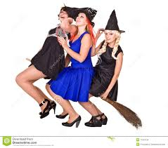 halloween witches costume in witch costume with a broom in his hand standing on stock