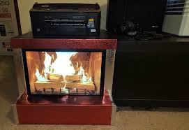 i repurposed an old dell monitor with speakers as a fireplace for