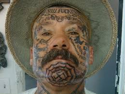 placasos on the face of prison gang members street gang mob