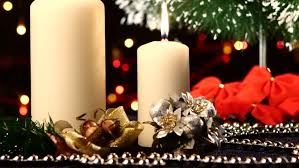 White Bow Christmas Decorations by Two Big Big White Candles With Christmas Decorations Like Red Bow