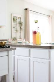how to paint your kitchen cabinets like a professional the best paint for painting kitchen cabinets kitchn
