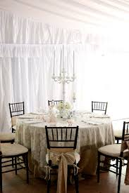 Shabby Chic White Chandelier Round Dining Table With Floral Pattern Tablecloth And White