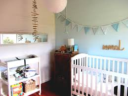 baby boy nursery room for small space with white crib and hanging