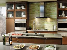 contemporary kitchen with glass panel by fieldstone cabinetry
