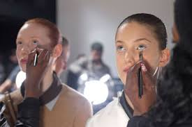 makeup artist in ri matte makeup and ballerina buns at doo ri nyfw fall 2012