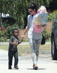 sandra bullock son sandra bullock held her son louis s hand on the way to a birthday