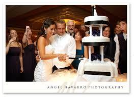 wedding cake cutting angel navarro cutting wedding cake reception florida