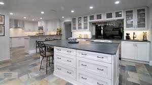 travertine countertops white shaker kitchen cabinets lighting