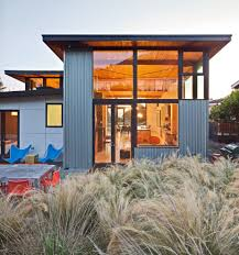 flat seam metal siding exterior beach style with flat roof