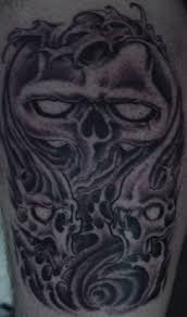 pictures of wings designs smoke and skull tattoos