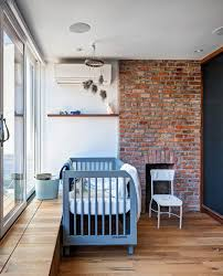 renovated 1890s brooklyn home with brick walls by gradient design view in gallery vintage brick fireplace in the modern nursery