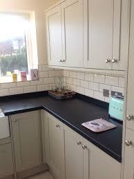 howdens greenwich shaker grey kitchen corian worktop in deep night
