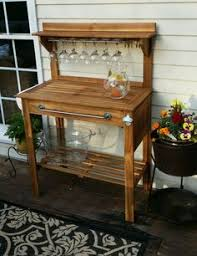 world market potting bench turned bar just added mirror trim to