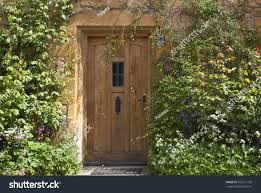 brown wooden doors old traditional english stock photo 592211795