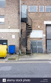 steel metal spiral staircase fire escape on industrial building uk