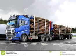2014 volvo truck tractor blue volvo fh16 700 timber truck with log trailer editorial stock