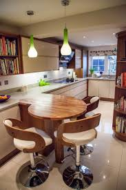 best ideas about small breakfast bar pinterest wooden round breakfast bar situating under lime green modern pendants with back white stools surrounds kitchen stoolssmall