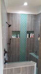 teal arabesque tile accent teal shower floor grey wood grain