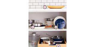 how to organize pots and pans in a cupboard how to organize your pots and pans real simple