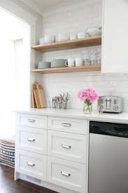 Floating Shelves Kitchen by Black Kitchen Countertops Crisply Contrast A White Subway Tile