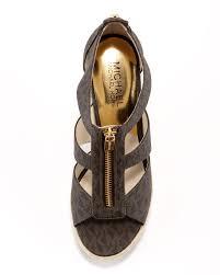 lyst michael michael kors damita logo zipper wedge sandal in natural
