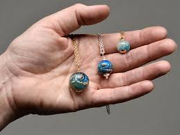 ashes into diamonds glass artist turns cremated remains into memorial pendants ecouterre