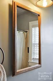 Bathroom Mirror Light Fixtures Inexpensive Makeovers For The Bathroom Mirror U0026 Light Fixture