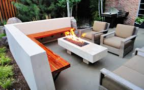 sleek modern outdoor living space in park hill mile high landscaping contemporary concrete seatwall bench with fire feature