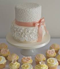 peach and white chocolate wedding cake and cupcakes a 2 tier