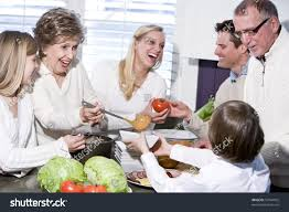 grandmother family cooking kitchen smiling laughing stock photo