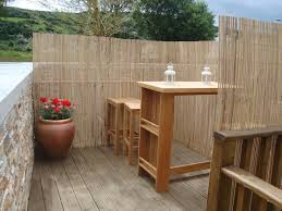 outdoor beautify your backyard deck with split bamboo fencing for