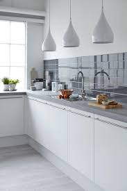 cream cabinet kitchen appliances flat stainless steel veny hood with wooden corner