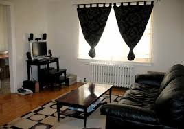 white living room wall themes with black curtains combined by