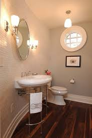 round mirror bathroom powder room traditional with oval mirror