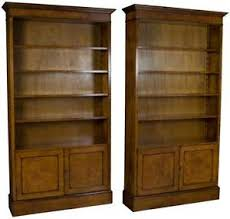 new matching pair of walnut tall bookcases with doors bookshelves