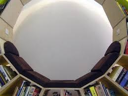 circular bookcase doubles as reading nook