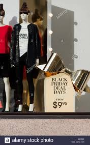 black friday sale ad in clothing store display window usa stock