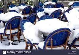 covered outdoor seating snow covered outdoor seating area in german cafe stock photo