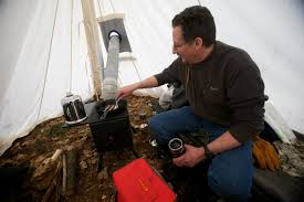 video motorcycle camping in the blizzard bennett there done that hogmaine fries bacon in the comfort of his wood heated tent saturday morning feb