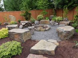 backyard landscaping with stone fire pit and boulders nice