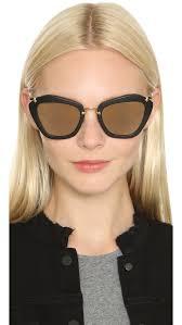 miu miu matte cat eye sunglasses in black lyst