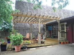Front Porch Post Wraps by Front Porch And Pergola With Stone Wrapped Posts Des Moines Deck