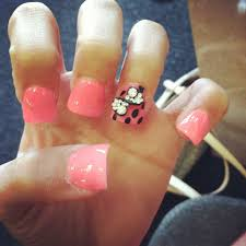 pink acrylic flare nails with black rhinestone bow with polka dots