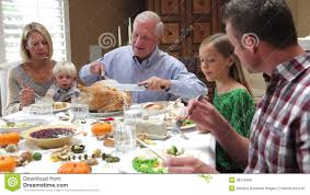 family at thanksgiving dinner grandfather carving turkey at family thanksgiving meal stock video