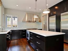 designer kitchen towels appliances pale blue tile backsplash with varnished oak flooring