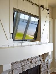 Wall Hung Tv Cabinet With Doors by Best 20 Tv Above Mantle Ideas On Pinterest Tv Above Fireplace
